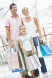 Family shopping in mall. Carrying bags Royalty Free Stock Photography