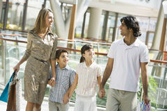 Family shopping in mall. Carrying bags royalty free stock image