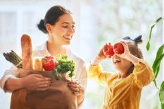Mother and daughter holding shopping bag stock images