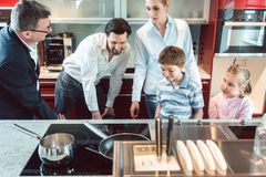 Family shopping for a new kitchen. Looking at details stock images