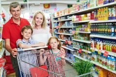 Family shopping. Parents with children and cart in supermarket store stock photos