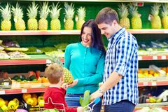 Family shopping in supermarket royalty free stock images