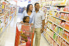 Family shopping in supermarket. Family shopping for groceries in supermarket stock photo