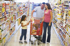 Family shopping in supermarket. Family shopping for groceries in supermarket royalty free stock photography