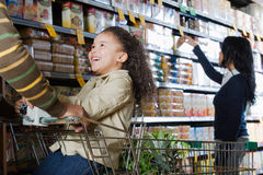Family shopping in a supermarket Royalty Free Stock Photo