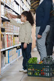 Family shopping in a supermarket Royalty Free Stock Image