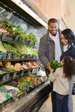 Family shopping in a supermarket Stock Images