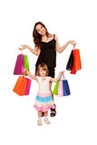 Two sisters, a teenager and a little girl holding up shopping b Stock Image