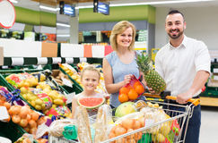 Family shopping various fresh fruits in supermarket Stock Photos