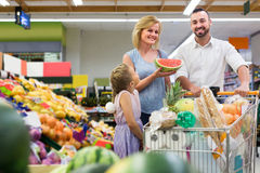 Family shopping various fresh fruits in supermarket Royalty Free Stock Images
