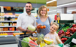 Family shopping various fresh vegetables in supermarket Royalty Free Stock Photography