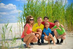 Family on shore. Family of five on  the beach Royalty Free Stock Photos