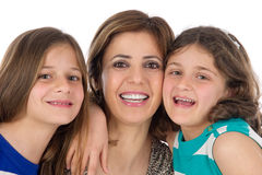 Family shot of mother and daughters hugging Stock Images