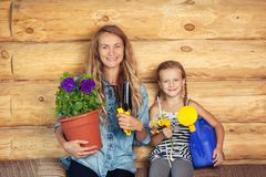 Woman and child in the garden stock photography