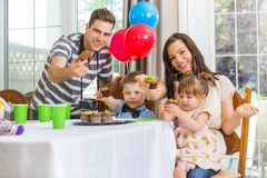 Family Showing Cupcakes At Birthday Party Stock Images