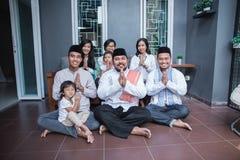 Family showing muslim greeting gesture. South asian people showing muslim greeting gesture together. eid mubarak celebration Royalty Free Stock Images