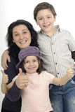 Family showing ok sign. Beautiful mother and her children posing in studio Royalty Free Stock Photo