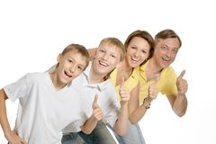 Family showing thumbs up Stock Images