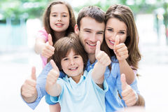 Family showing thumbs up Stock Photography