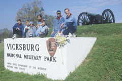 Family on sign on green grass at entrance of Vicksburg National Military Park, MS Stock Photography