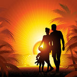 Family silhouette on the beach Stock Photography