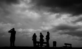 Family silhouette  dark times. Family silhouette representing dark times , father looking too the future Royalty Free Stock Photography