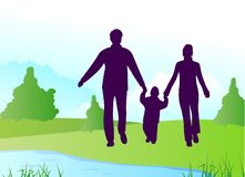 Family silhouette on river Royalty Free Stock Photography