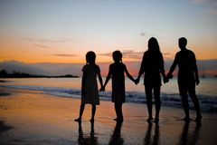 Family silhouette in the sunset at the beach. Family silhouette in the sunset on beach vacation Stock Photography