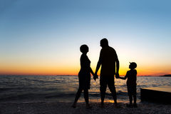 Family Silhouette. Sunset at sea stock photography