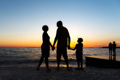 Family Silhouette. Sunset at sea stock image