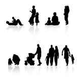 Family silhouettes. Vector silhouettes of parents with children Royalty Free Stock Photo