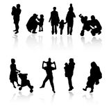 Family silhouettes. Vector silhouettes of parents with children Royalty Free Stock Image