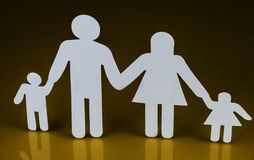 Family silhouettes with children isolated on yellow background. Conceptual image Royalty Free Stock Image