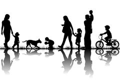 Family silhouettes in nature Royalty Free Stock Image