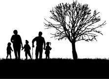 Family silhouettes in nature. Stock Photos