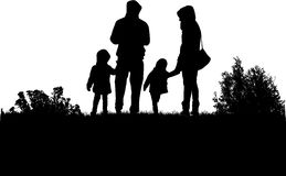 Family silhouettes in nature. Royalty Free Stock Image