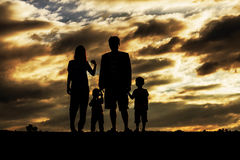 Family with the silhouettes. Royalty Free Stock Photos