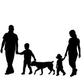 Family silhouettes with two children and dog Stock Images