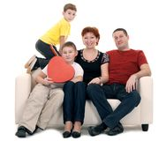 Family silit on the couch Stock Image