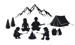 Family sit around campfire silhouette scene. With mountains, tent and pine trees. People camping outdoor Royalty Free Stock Images
