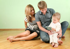 Family sit on floor Stock Image