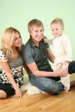 Family sit on fur carpet Royalty Free Stock Image