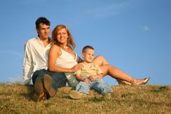 Family sit on the meadow Stock Photos