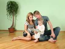 Family sit in the room on floor Royalty Free Stock Images