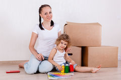 Family sit in a room near the boxes. Royalty Free Stock Image