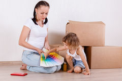 Family sit in a room near the boxes. Royalty Free Stock Photography