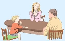 Family sit at a table Royalty Free Stock Photo