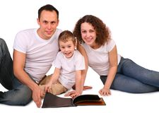 Family sits and reads magazine Royalty Free Stock Image