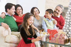 Family Sitting Around A Coffee Table Royalty Free Stock Photo