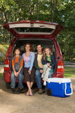 Family sitting in back of car Royalty Free Stock Photography